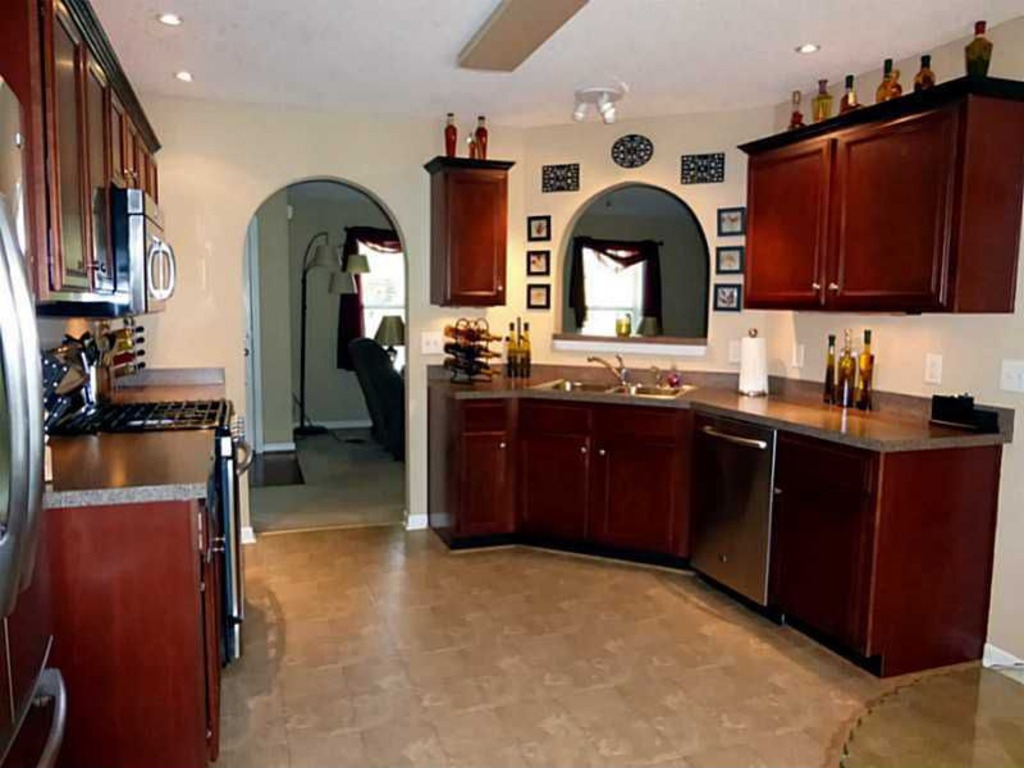 Beautiful Kitchen with Accent Lighting and Arched Accents.