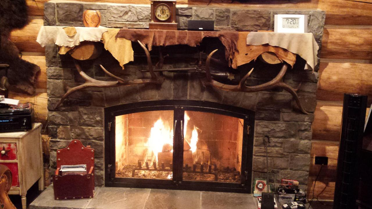 Roaring Fire in Custom Stone Fireplace