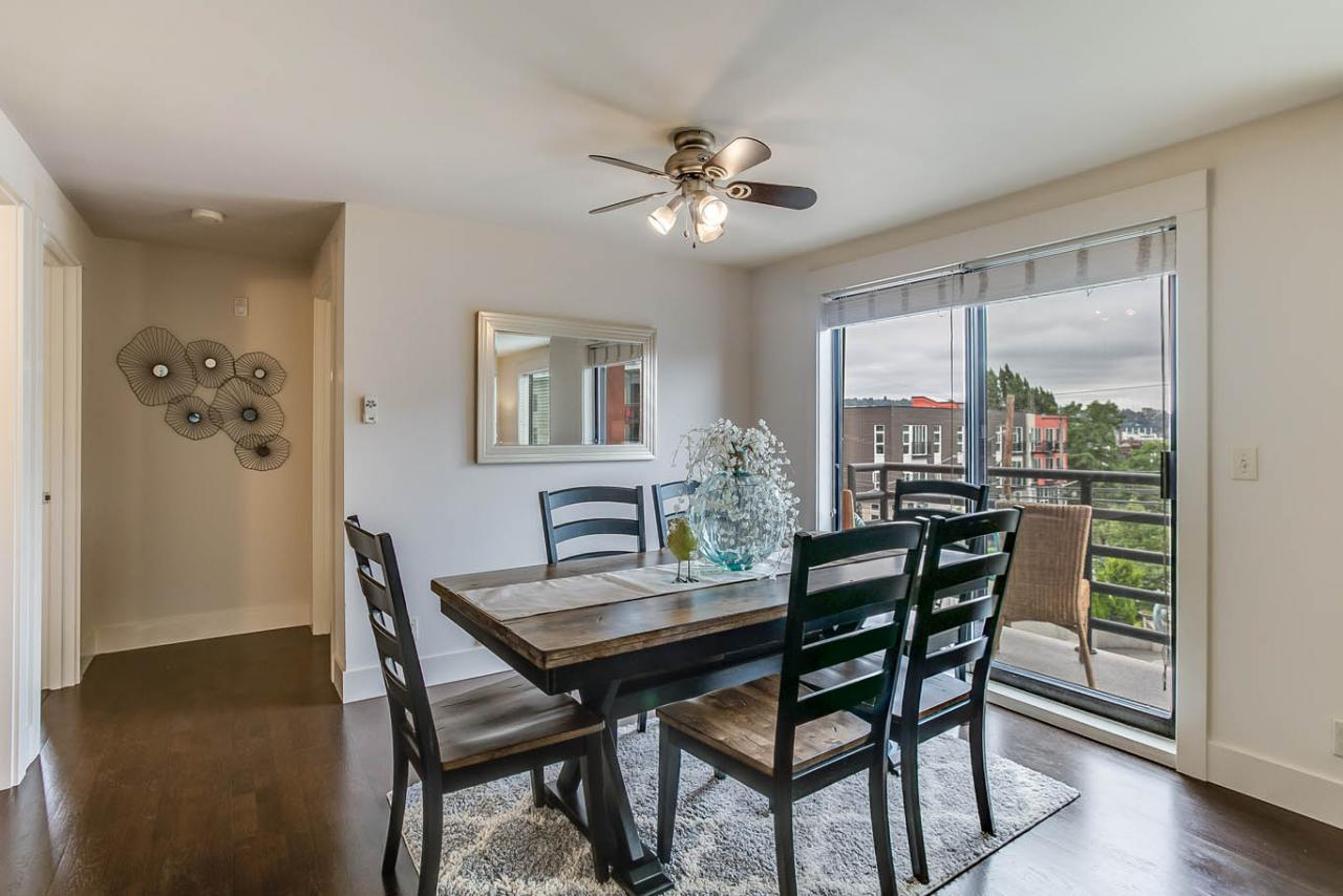 Lovely dining area with ceiling fan opens to the view deck.