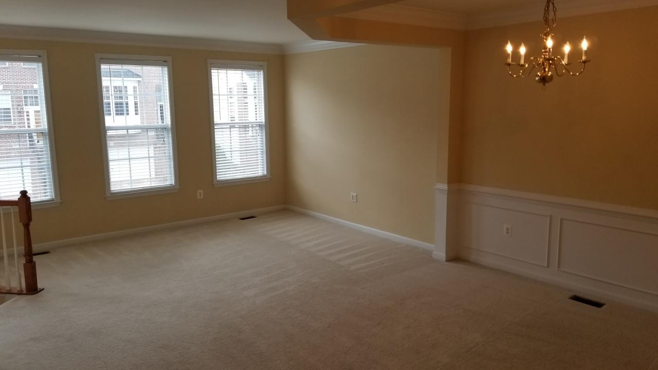 FLOWING LIVING ROOM W/ WALL TO WALL CARPETING